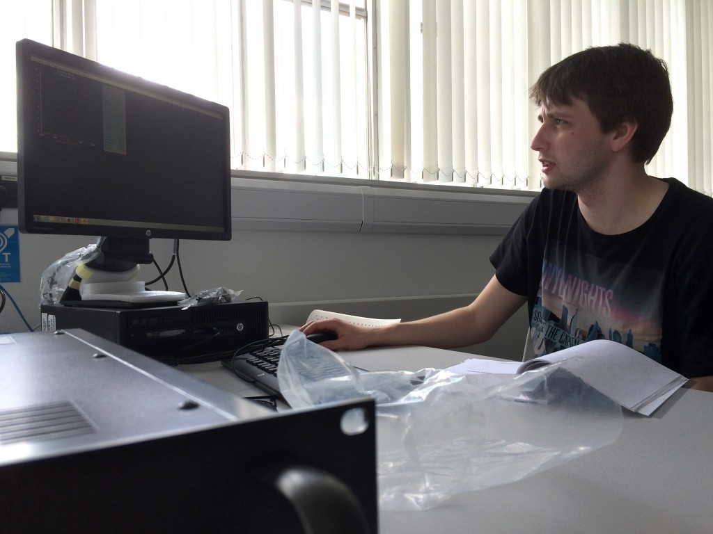 PhD student, Michael Jones, sat at the computer setting up the Spectracyber software for taking the first ever test readings from our equipment.